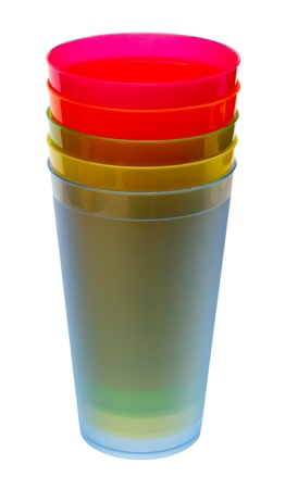 Multicolored plastic glasses for juice isolated on white background