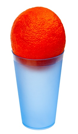 An orange in a blue plastic glass, isolated on a white background