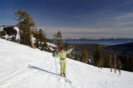 A young attractive woman enjoys the winter at a ski resort at northern Lake Tahoe, California. Stock fotó
