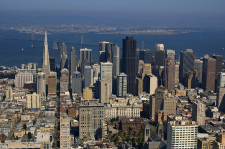 oakland: An aerial view of downtown San Francisco and Bay Bridge (Oakland port in the background) lit by a warm late afternoon sun. Stock Photo