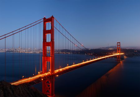 stitched: High-resolution stitched image of Golden Gate Bridge glowing in the dusk.
