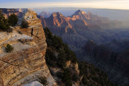 viewpoint: Wotan throne lit by the setting sun - the path to Bright Angel Viewpoint is on the left. North Rim of Gran Canyon, Arizona. Stock Photo