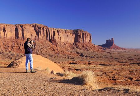 tribal park: Young male is hotographing Monument Valley Tribal Park, Navajo Nation, Utah