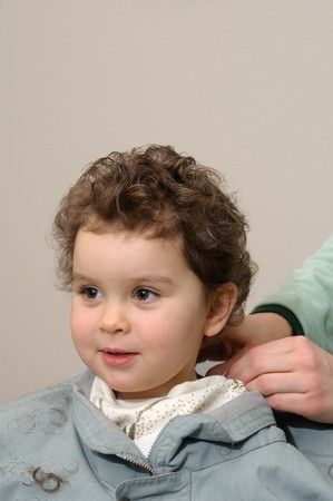 haircut: Two year old girl gets haircut at home (moms hands are putting the finishing touches) Stock Photo