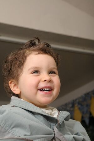 haircut: Two year old girl is laughing during haircut at home