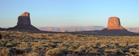 barren: Dawn in Monument Valley - tribal park belonging to Navajo Nation - panoramic stitched image. Stock Photo