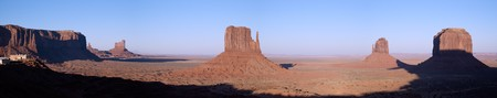 panoramics: A panorama shot of West Mitten, East Mitten and Merrick Buttes and visitor centre lit by the setting sun in Monument Valley (Navajo Nation).