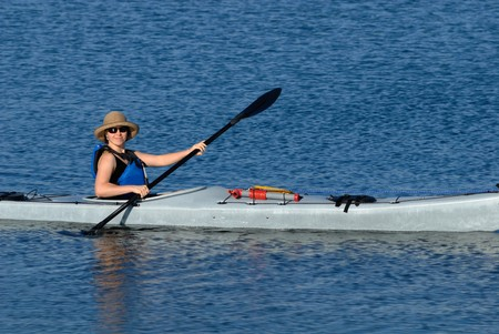 lifevest: A smiling attractive young woman in sea kayak. Mission Bay, San Diego, California