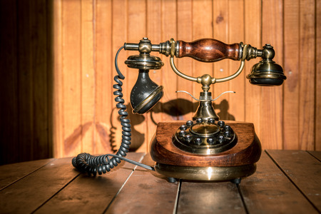 Vintage telephone at wooden background