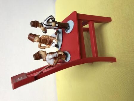 Chocolate Figurines Playing on a Chair