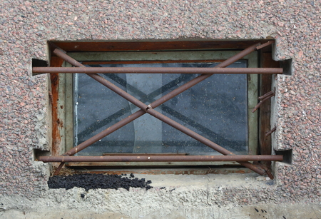 Basement window with a metal barrier Stock Photo