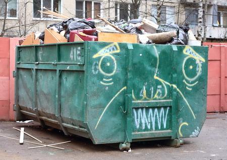 Large garbage container, big full of garbage