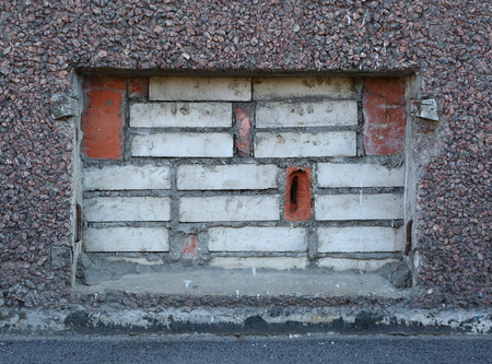 Basement window with bricks