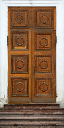 Big old light wooden door