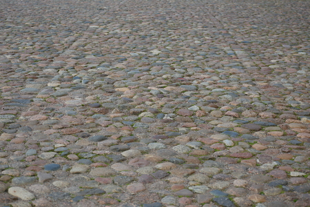 Ancient cobblestone covering of the old square
