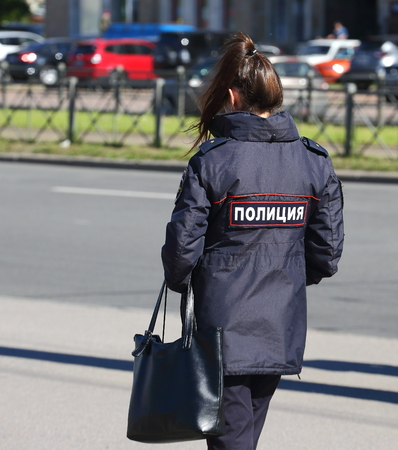 A female officer of the Russian police with a bag Stock Photo