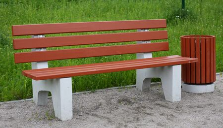 Park bench made of concrete and wood. Imagens