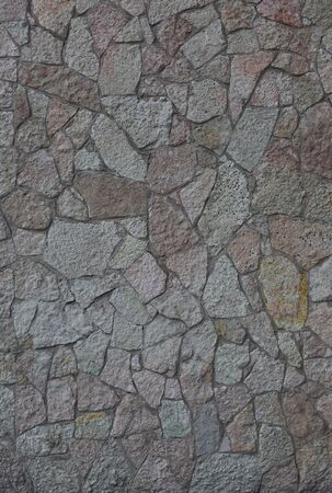 Wall faced with stone
