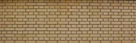 Wall of yellow brick Stock Photo