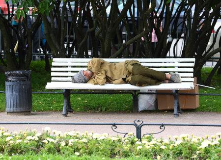 Sleeping on a bench homeless, Nevsky Prospekt Peterburg Russia July 2019 Editorial