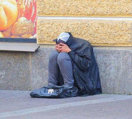 Homeless beggar on the street Foto de archivo