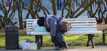 Sleeping on a bench homeless, Nevsky Prospekt, Saint Peterburg, Russia March 2020 Editorial