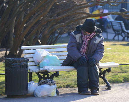 Sitting on a bench homeless, Nevsky Prospekt, Saint Peterburg, Russia March 2020