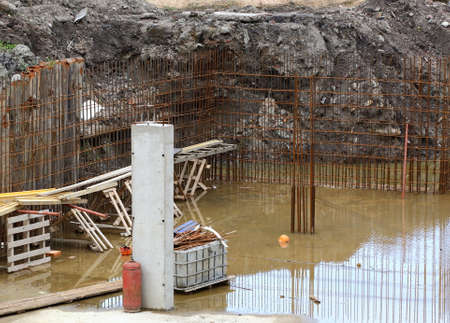 A pit filled with water on a construction site