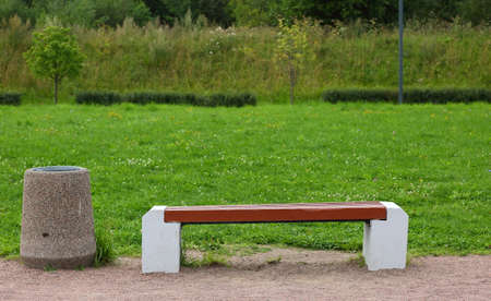Park bench made of wood and concrete with a stone urn in the Park Banco de Imagens - 153345798