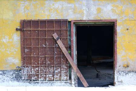 The metal door to the basement was wide open Banco de Imagens - 153517224