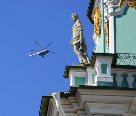 Tourist helicopter in the sky over the Winter Palace, Palace square, Saint Petersburg, Russia, august2020 Banco de Imagens - 153791251
