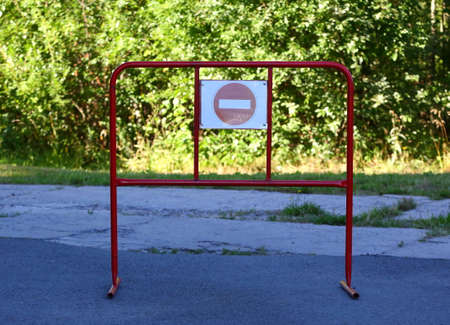 Red metal barrier with Stop sign Banco de Imagens - 154157646