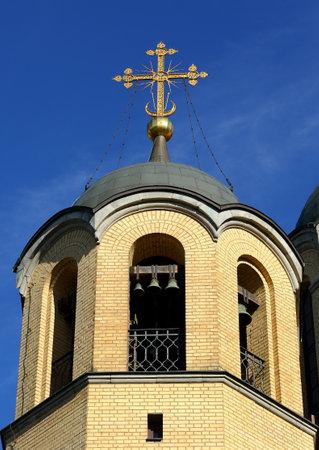 Bell tower of the yellow brick Orthodox Church, Rozhdestvenskaya Church, ulitsa Kollontai 17, Saint Petersburg, Russia, August 2020