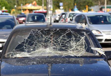 The broken cracked windscreen of a car