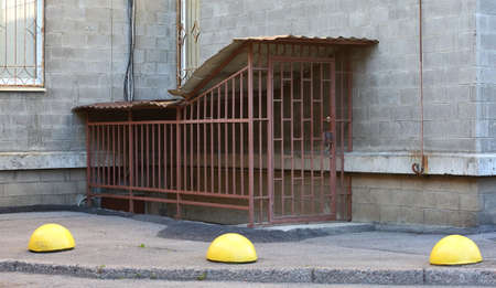 Entrance to the basement with metal grating