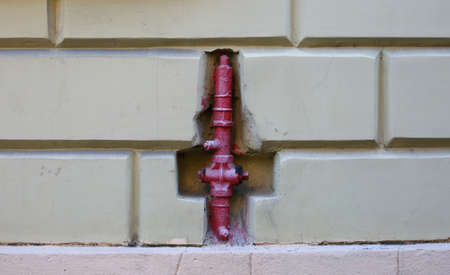 Red fire hydrant in the wall of the house Banco de Imagens - 155317240