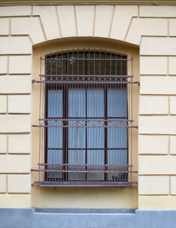 A big window with a metal barrier Banco de Imagens - 155414717