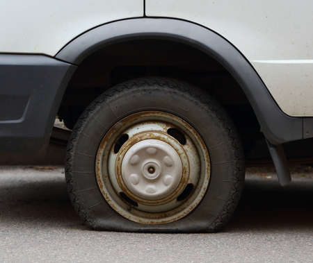Punctured wheel of a small car