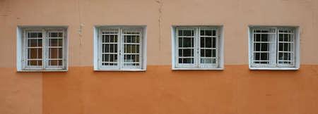A four square windows with a metal barrier Banco de Imagens