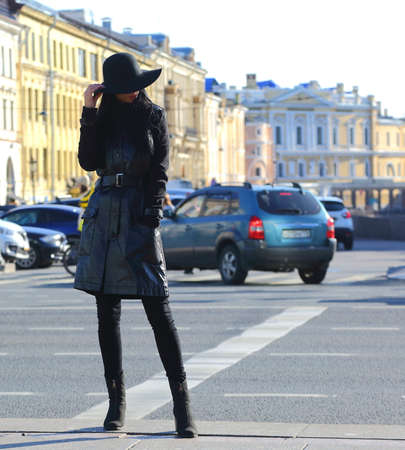 A girl in a leather coat and wide-brimmed hat on the street, Nevsky Prospekt, Saint Petersburg, Russia, September 2020 Editorial