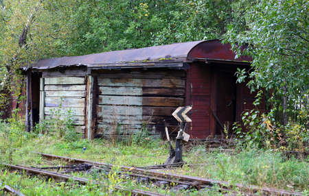 Old wooden building at the fork of an abandoned railway