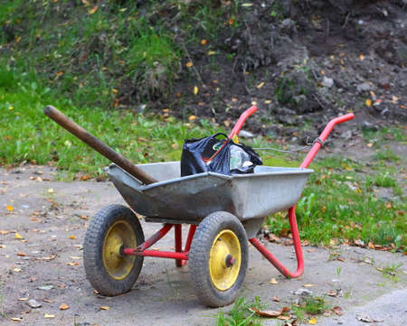 Two-wheeled metal wheelbarrow for gardening and agricultural work