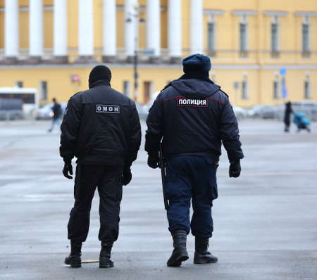 Two policemen on patrol in the city square, Palace Square, St. Petersburg, Russia, March 2021 Editorial
