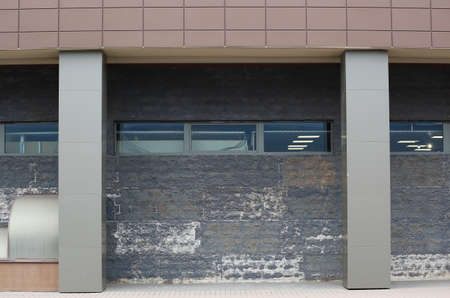 Facade of an industrial building with metal columns