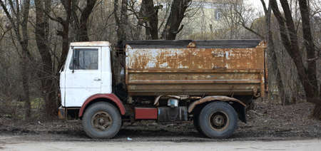 Old rusty truck with a white cab