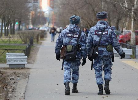 Two Russian guardsmen on a public order patrol, Iskrovsky Prospekt, Saint Petersburg, Russia, April 2021