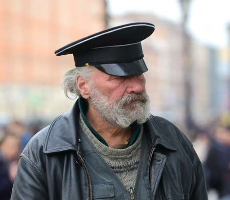 A plump, gray-bearded man in a black cap, Nevsky Prospekt, Saint Petersburg, Russia, April 2021