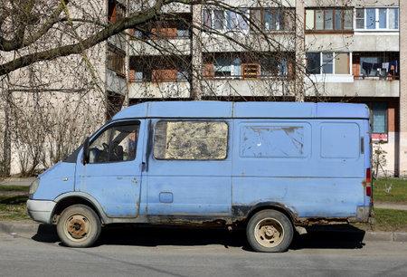 Old rusty blue van in the courtyard of a residential building, ulitsa Podvoyskogo, Saint Petersburg, Russia, April 2021