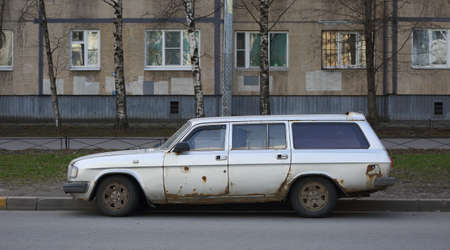 Old rusty Soviet car on the street, Iskrovsky Prospekt, Saint Petersburg, Russia, April 2021