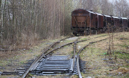 Freight train at an old abandoned station Banco de Imagens